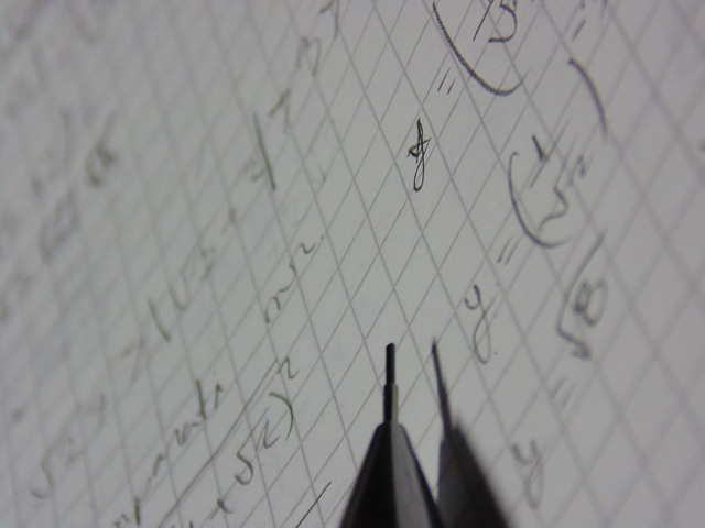 Graph paper with work